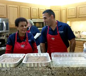 Carnegie's Raz Pounardjian and Gwen Graham serving at Ronald McDonald House of Cleveland
